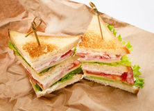 Sandwichs sur le papier Photo stock