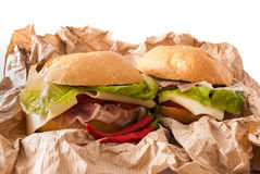 Sandwichs sur un papier Image libre de droits