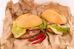 Sandwichs sur un papier Photo libre de droits