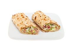 Sandwichverpackungen auf einer Platte Stockbild