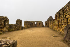 The sandy area in the ruins of the Inca city. Of Machu Picchu, Peru in foggy and rainy weather Royalty Free Stock Images