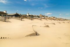 Sandy Atlantic ocean beach. Beach houses. royalty free stock image