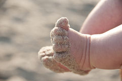 Sandy baby feet Royalty Free Stock Images