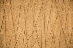Sandy background closeup diagonal lines. Crossing lines sandy abstract background nature yellow Royalty Free Stock Photography