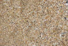 Sandy background. Consists of broken sea shells Royalty Free Stock Photography