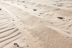 Sandy background, texture of an arid sand desert stock image