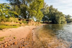 Sandy bank of a wide Dutch river Stock Image