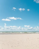 Sandy beach. And blue cloudy sky Royalty Free Stock Image