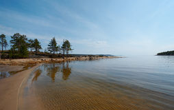 Sandy beach. On the bank of Ladoga lake in a summer sunny day Stock Photos