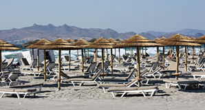 Sandy beach. With lounge chairs and umbrellas Royalty Free Stock Photography