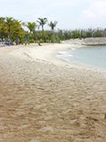 Sandy beach. Long stretch of tropical man-made beach with breakwater royalty free stock photography