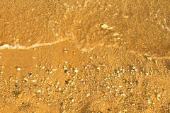 Sandy beach andwave Royalty Free Stock Images