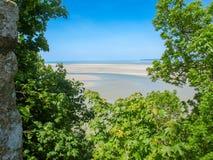 Sandy beach around Mont Saint Michel. Sandy beach, view from a walk around Mont Saint Michel Stock Photo