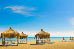 Sandy beach, awnings sunbeds Royalty Free Stock Photography