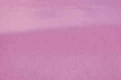 Sandy beach background. Pink Sandy beach background. Detailed sand texture and water . Top view Royalty Free Stock Images