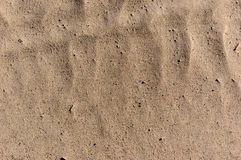 Sandy beach background summer theme. Sand texture. Macro shot of sand with weaves Royalty Free Stock Photos