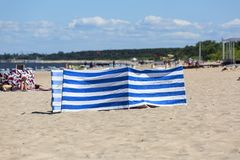 Sandy beach on the Baltic sea, people resting on a sunny summer day, sunshade, Sopot, Poland. SOPOT, POLAND - JUNE 6, 2018: Sandy beach on the Baltic sea, people royalty free stock image