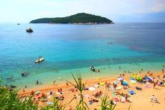 Sandy beach Banje, near Dubrovnik touristic destination in Croatia. Tourists sunbathing on sandy beach Banje, near Dubrovnik touristic destination in Croatia Royalty Free Stock Photo