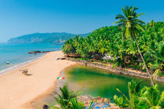 Sandy beach in the beautiful resort location. In Goa stock photo