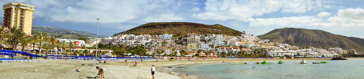 Sandy beach with blue parasols and sunbeds, Los Cristianos, Tene Stock Photos