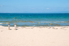 Sandy beach and blue sea. stock images