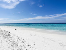 Sandy beach and blue skies Stock Image
