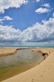 Sandy beach with blue sky and clouds. Sandy beach with blue sky and the clouds Royalty Free Stock Photos