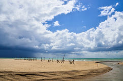 Sandy beach with blue sky and clouds Stock Photo