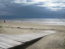 Sandy beach boardwalk Royalty Free Stock Image
