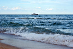 Sandy beach and boat Royalty Free Stock Images