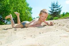 Sandy beach. Boy playing on the sandy beach stock photo