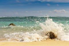 Sandy beach, breaking waves on the rocks. Indian ocean. Gradatio Stock Photo