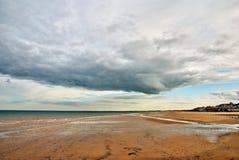 Sandy beach at Bridlington. The sandy beach and shore at Bridlington, England under a cloudy sky Stock Photography