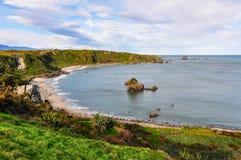Sandy beach in Cape Foulwind, New Zealand Stock Photos