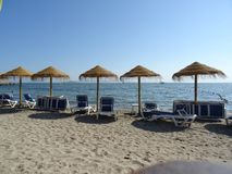 Sandy beach, chairs and umbrellas in La Manga, Spain royalty free stock photography