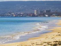 Sandy beach and city on a sunny day. The sandy beach and city on a sunny day Royalty Free Stock Images