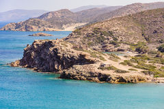 Sandy beach and clear blue water at lagoon of Crete island Royalty Free Stock Images