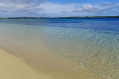 Sandy beach and clear water, Ofu island, Tonga Stock Images