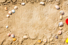 Sandy beach closeup, Seacoast sand background. Space for text. Stock Photography