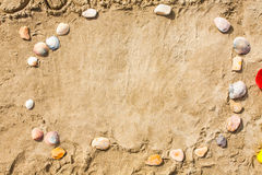 Sandy beach closeup, Seacoast sand background. Space for text. Royalty Free Stock Image