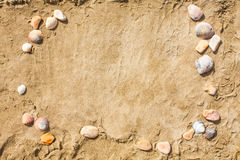 Sandy beach closeup, Seacoast sand background. Space for text. Stock Images