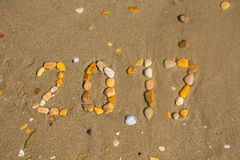 Sandy beach closeup, Seacoast sand background. Text 2017 made with stones. Stock Photo