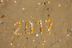 Sandy beach closeup, Seacoast sand background. Text 2017 made with stones. Stock Photography