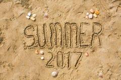 Sandy beach closeup, Seacoast sand background. Text Summer 2017. Stock Photo
