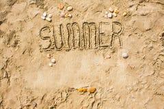 Sandy beach closeup, Seacoast sand background. Text Summer. Stock Image