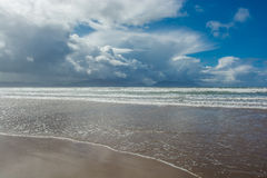 Sandy Beach with Clouds in Ireland Stock Photo