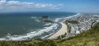Sandy beach and coastal town from the mountain