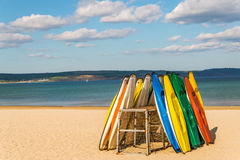 Sandy beach, color kayaks based on stand, in background beautifu Stock Image