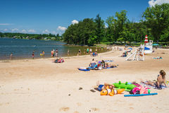 Sandy Beach at a Community Park. Franklin County, VA – May 29th: People enjoy a sandy beach on a beautiful summer's day at the Smith Mountain Lake Community Stock Image