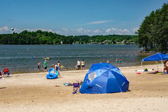 Sandy Beach at a Community Park. Franklin County, VA – May 29th: People enjoy a sandy beach on a beautiful summer's day at the Smith Mountain Lake Community Royalty Free Stock Images